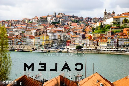 Porto, Portugal - April 21, 2012: View towards Porto over the Calem wine cellar roof. Calem is one of recognizable Porto Wine companies..