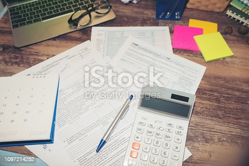 istock Calendar 2019 and Individual Income Tax Form For who have income According to United States law.This is the season that has to pay taxes,deadline of tax payment. 1097214252
