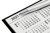 istock Calendar 2021 and ballpen isolated against white background 1294255919