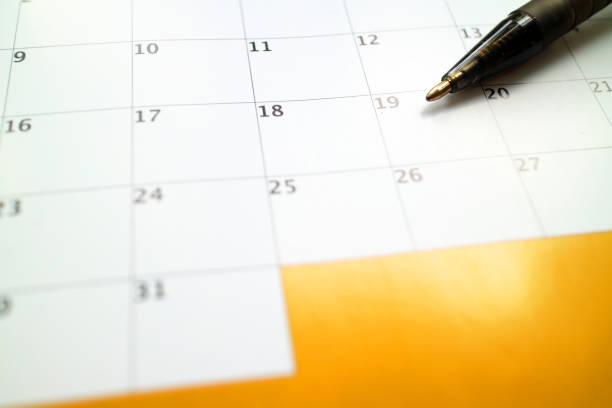 Calendar and pen, planning concept stock photo
