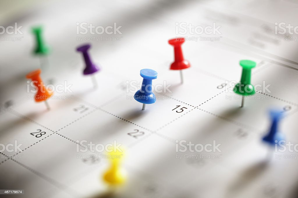 Calendar appointment Push pin in calendar concept for busy, appointment and meeting reminder 2015 Stock Photo