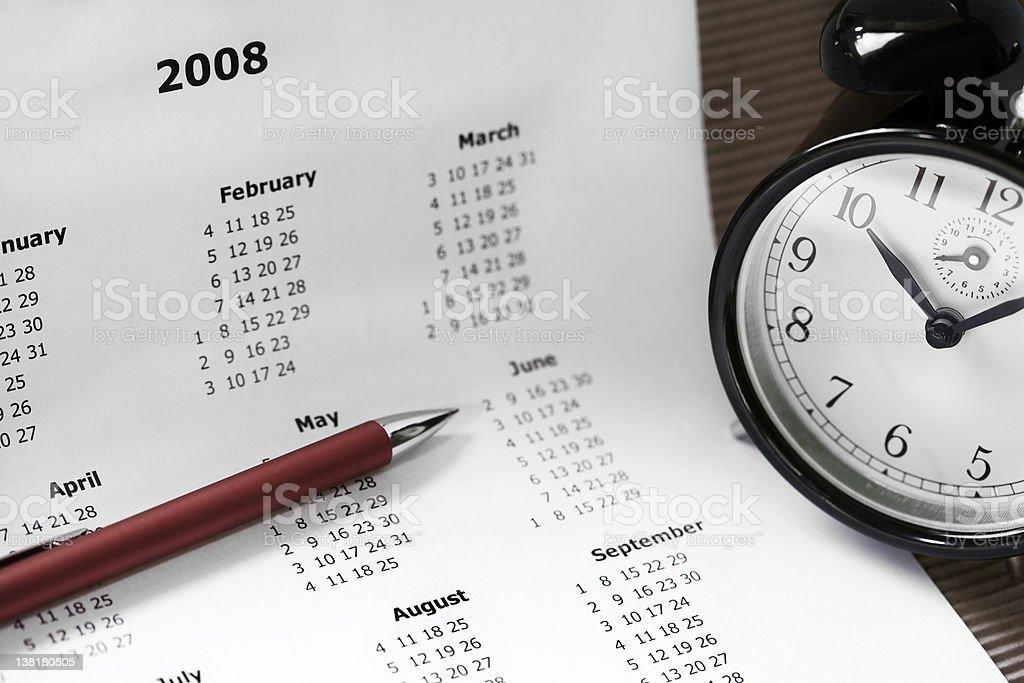 Calendar, clock and pen stock photo
