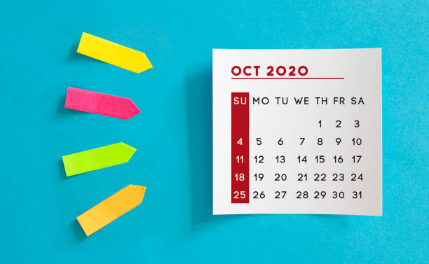 Calendar concept. October 2020 Calendar On The White note paper. Colored arrow-shaped sticky notes point to it. stock photo