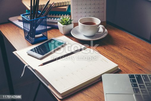 Diary,Calendar and agenda for Planner to plan timetable,appointment,organization,management on table.Desktop Calender 2019,laptop and cup of coffee place on wooden office desk.Calendar Concept