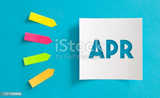 1124594277 istock photo Calendar concept. White note paper with APR text. Colored arrow-shaped sticky notes point to it. 1221369868