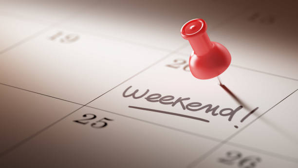 Calendar Concept with a red pin Concept image of a Calendar with a red push pin. Closeup shot of a thumbtack attached. The words Weekend written on a white notebook to remind you an important appointment. sunday stock pictures, royalty-free photos & images