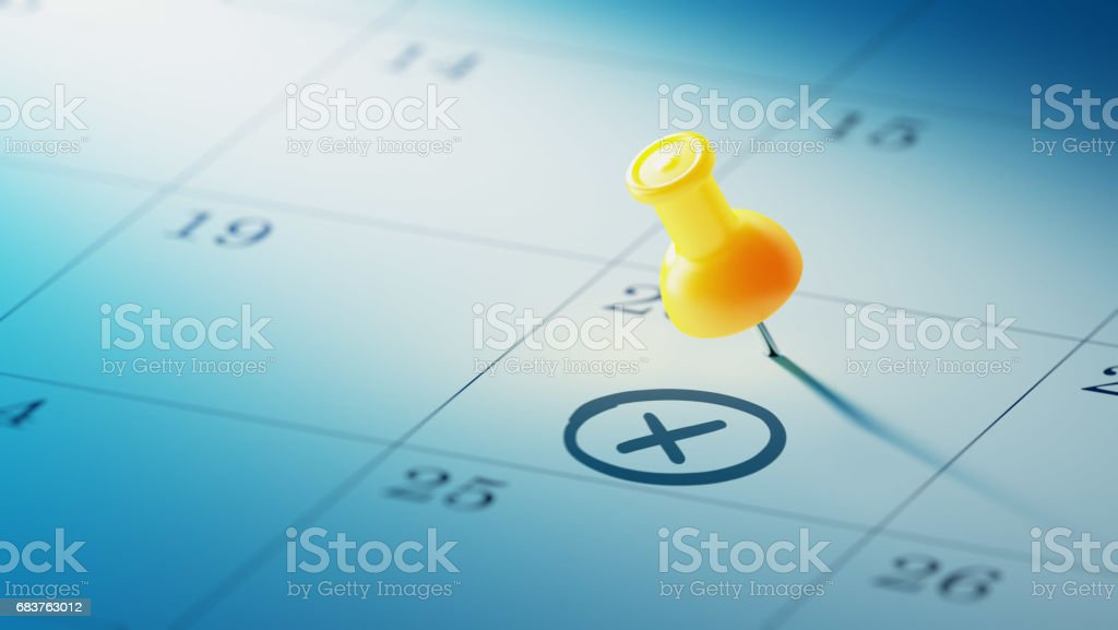 Calendar Concept with a yellow pin stock photo