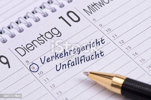 istock calendar date for traffic court and hit-and-run driving- in German language: Verkehrsgericht wg. Unfallflucht 1002727854