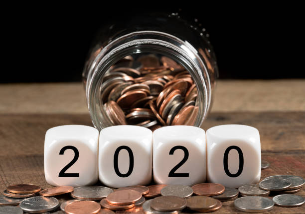 Calendar for 2020 New Year holiday background with cash savings stock photo