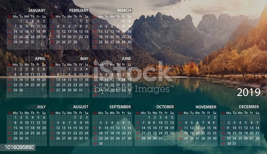 istock Calendar in English for 2019 on beautiful landscape of Italian Dolomites. Week starts on sunday. USA format 1016095892
