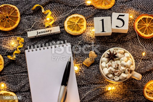 istock calendar January 15th Cup of cocoa and empty open notepad 1068276142