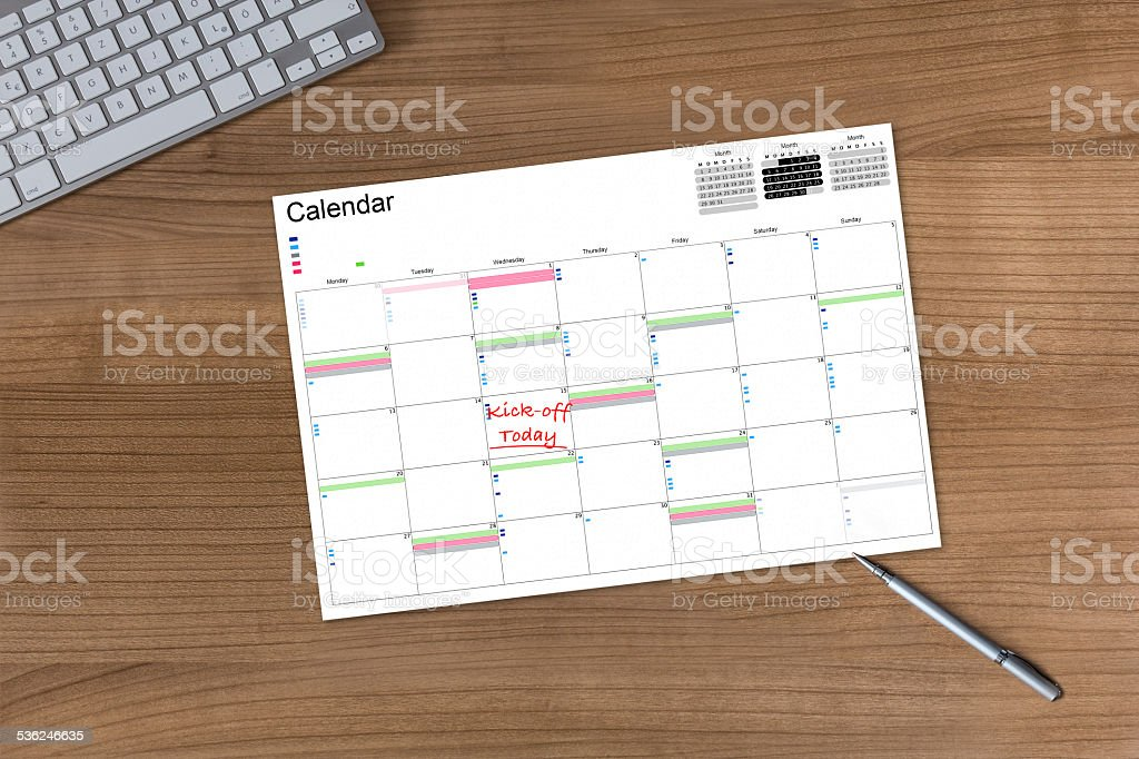 Calendar Kick-off today on wooden Table stock photo