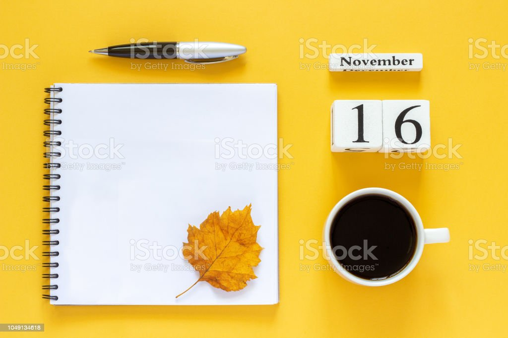 Autumn composition. Wooden calendar November 16 cup of coffee, empty...