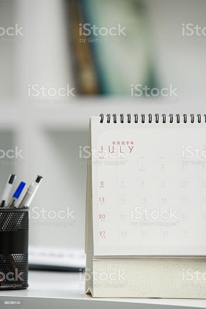 Calendar on desk stock photo
