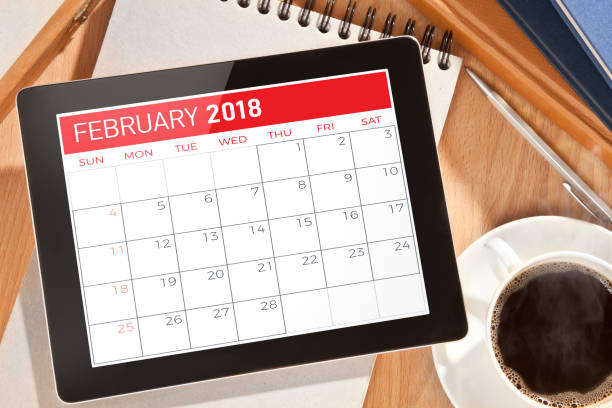 calendar on digital tablet - february stock photos and pictures
