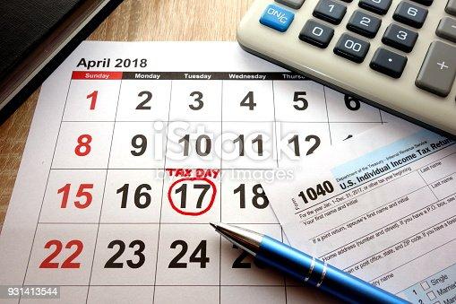 istock Calendar on office desk showing date April 17 2018 931413544