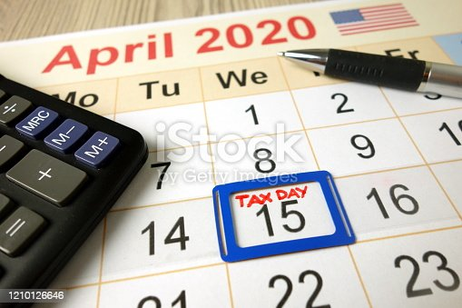 1170746979 istock photo Calendar on office desk showing tax day for filling - April 15 2020 1210126646