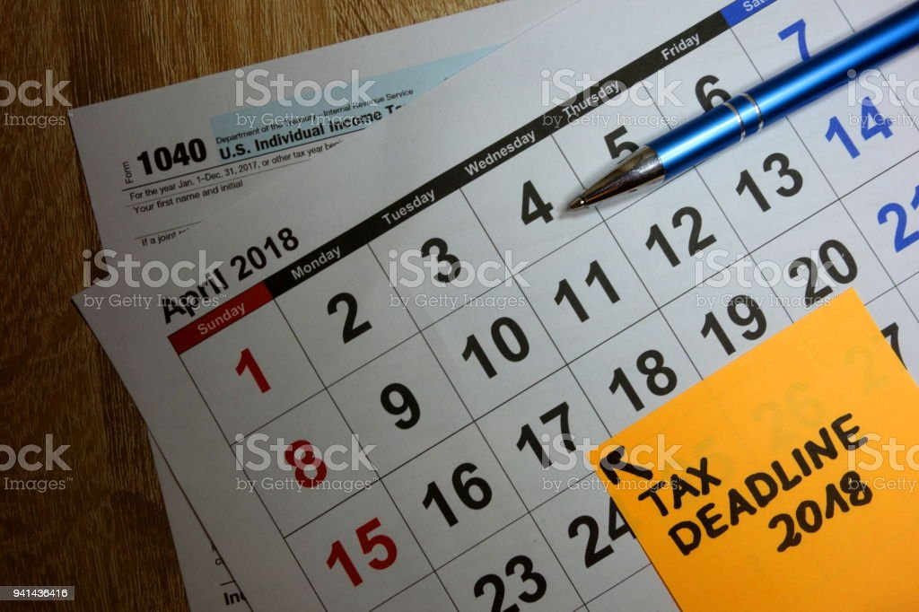 Calendar on US 1040 income tax form showing filing deadline as April 17 2018 stock photo