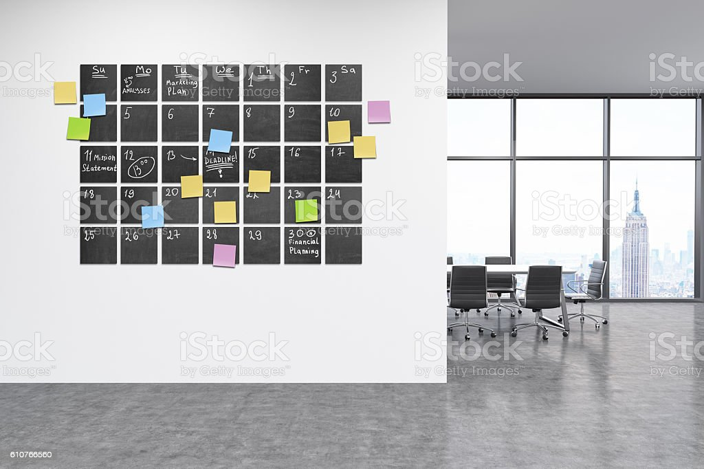 Calendar on wall in office stock photo