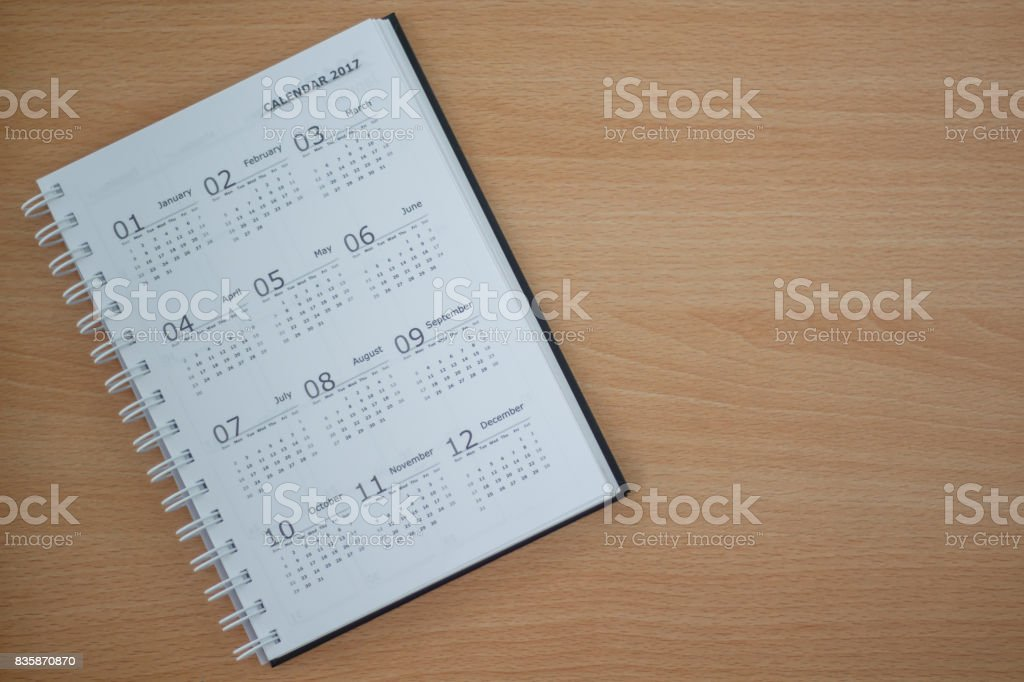 Calendar on wooden background copy space. stock photo