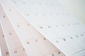istock Calendar page flipping sheet close up blur background business schedule planning appointment meeting concept 1241235622