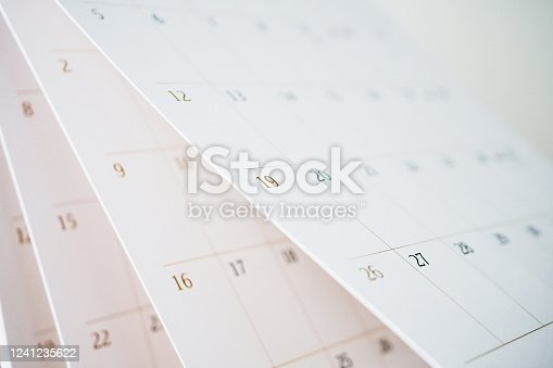 Calendar page flipping sheet close up blur background business schedule planning appointment meeting concept