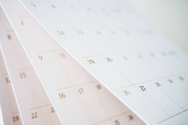 Calendar page flipping sheet close up blur background business schedule planning appointment meeting concept Calendar page flipping sheet close up blur background business schedule planning appointment meeting concept calendar stock pictures, royalty-free photos & images