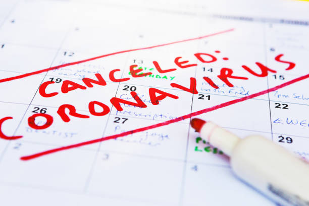 Calendar page full of appointments canceled because of the covid-19 coronavirus pandemic stock photo