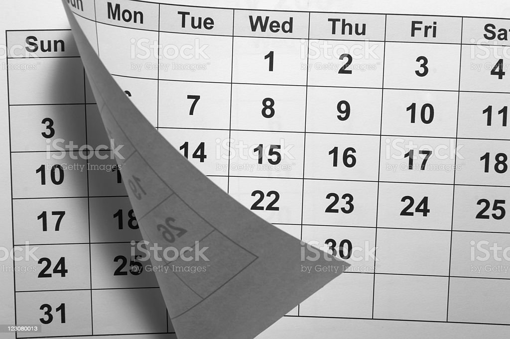 Calendar page tearing off another one stock photo