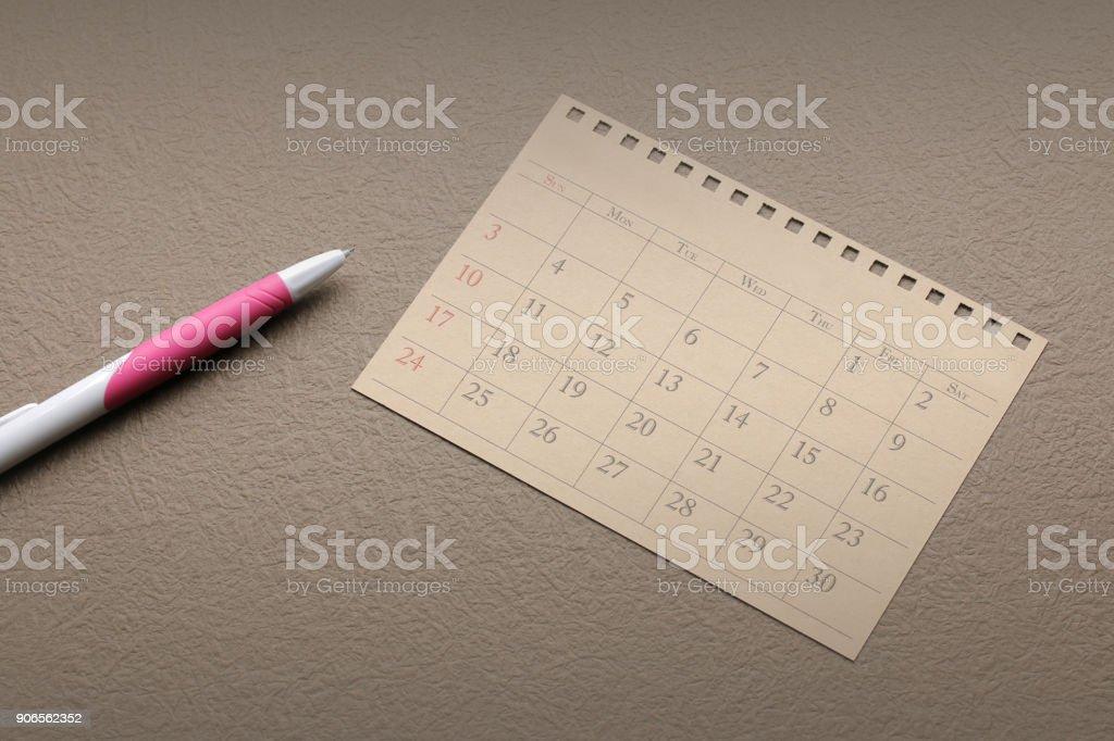 calendar planner or schedule arrangement on vintage paper background stock photo