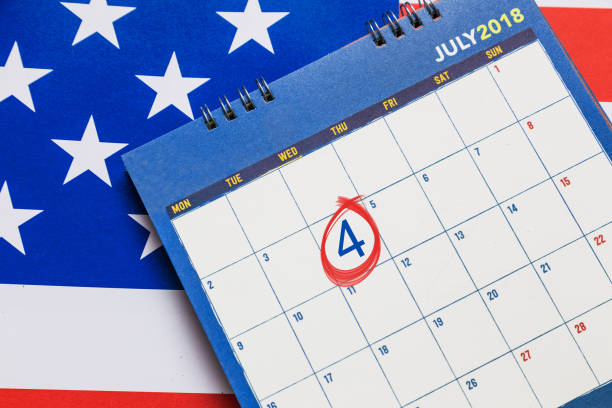 calendar showing july month with red circle on 4th day with american flag in background, good for 4th of july theme - fourth of july стоковые фото и изображения