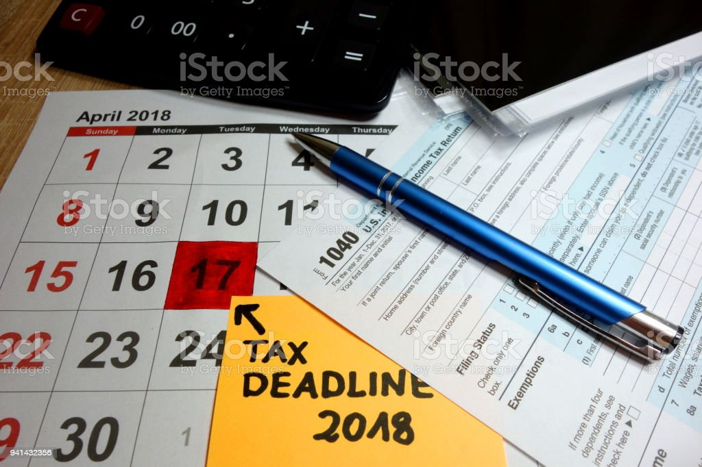 Calendar showing tax deadline for filing forms stock photo