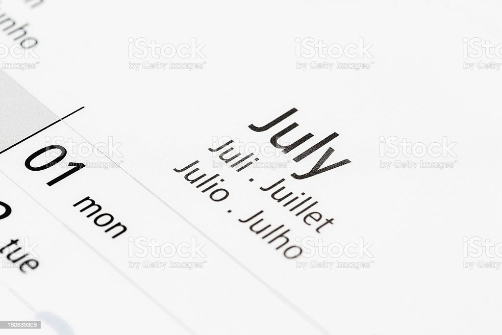 Calendar shows July, labelled in many languages royalty-free stock photo