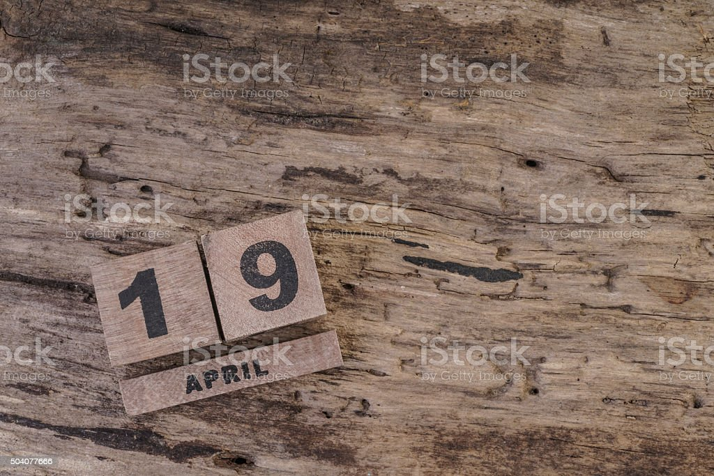 Calendar Template With Wooden Cubes For April On Wooden Background