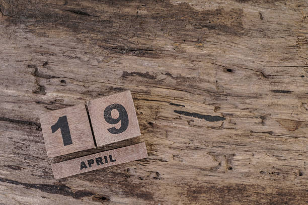 calendar template with wooden cubes for april on wooden background - number 19 stock photos and pictures