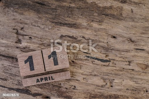 istock calendar template with wooden cubes for april on wooden background 504078376