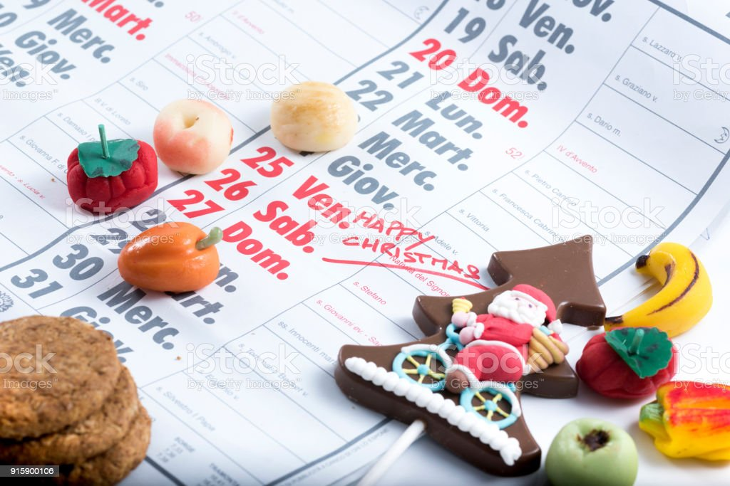 calendar with Christmas day marked beside decorations and sweets stock photo