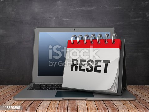 RESET Calendar with Computer Laptop on Chalkboard Background - 3D Rendering