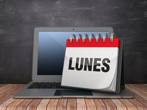 LUNES Calendar with Computer Laptop - Spanish Word - Chalkboard Background - 3D Rendering