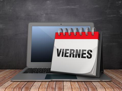 VIERNES Calendar with Computer Laptop - Spanish Word - Chalkboard Background - 3D Rendering