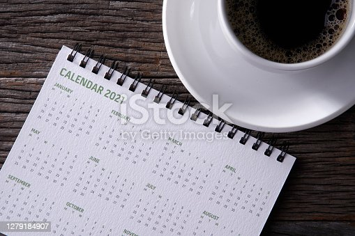 Happy new year 2021 concept: Close up calendar and coffee on desktop