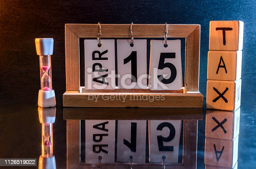 947260978 istock photo Calendar with date 15th April and cubes with word 'tax' 1126519022