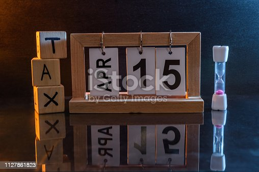 947260978 istock photo Calendar with date 15th April and cubes with word 'tax' 1127861823