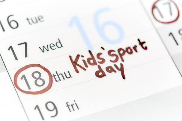 Calendar with date for Kids' sport day circled in pen On an otherwise blank calendar, a felt-tip pen has ringed Kids' Sport Day apostrophe stock pictures, royalty-free photos & images