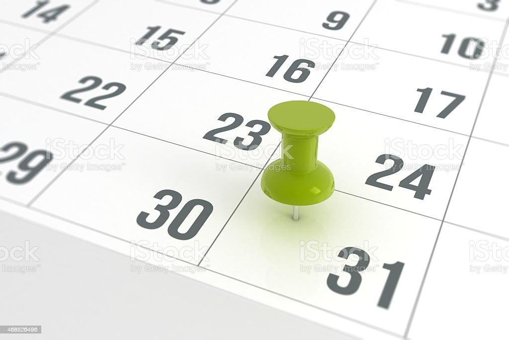 Calendar with green Pushpin stock photo