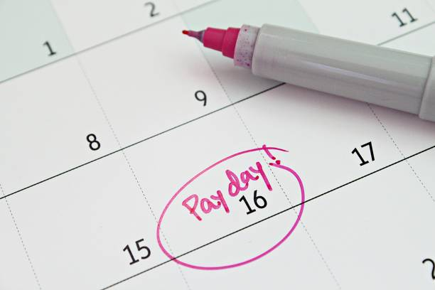 Calendar with pink marker circle in word payday for remind Business, finance, savings money, wages, payroll or accounting concept : Calendar with pink marker circle in word payday for remind wages stock pictures, royalty-free photos & images