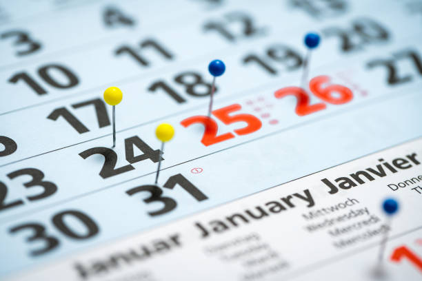 calendar with pins marking the christmas holidays stock photo