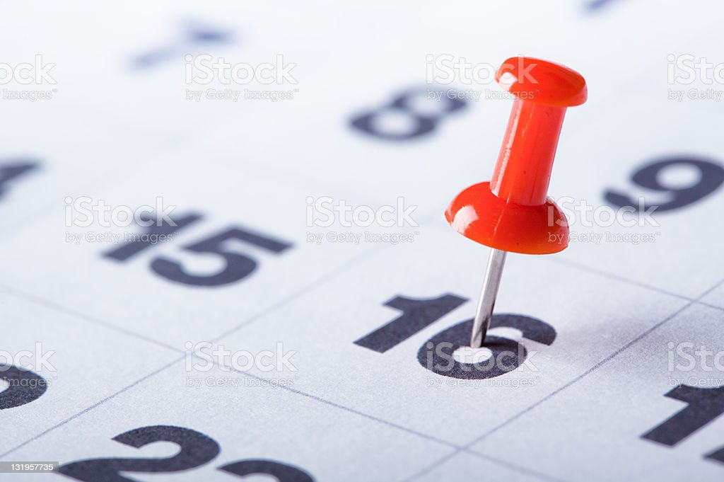 Calendar with red pin stock photo