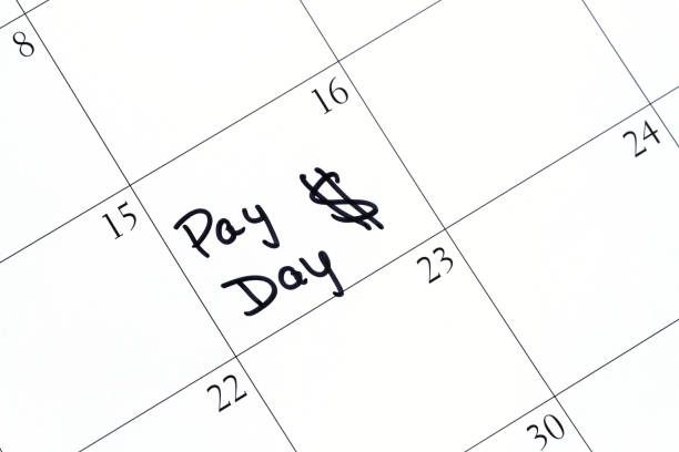 Calendar with reminder note saying Pay Day with a dollar sign stock photo