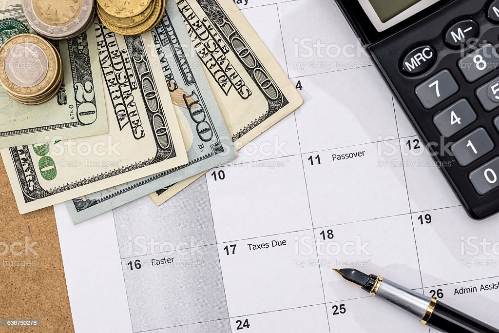 Calendar With Tax Due Date And Us Money Pen Calculator Stock Photo